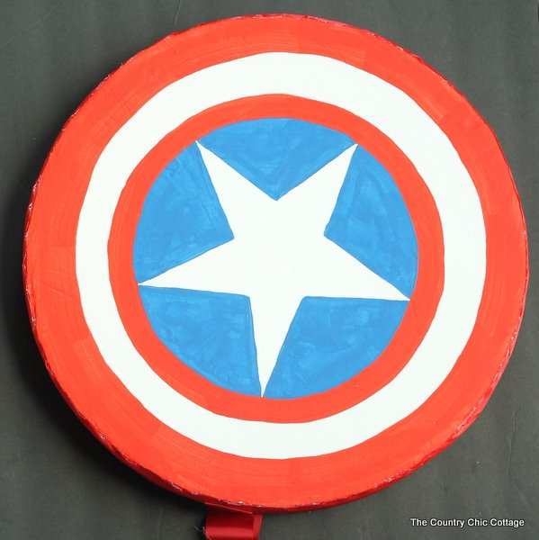Make your own Captain America shield -- a wreath form and some poster board can be easily turned into a Halloween costume accessory!