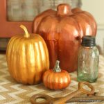 Metallic Painted Pumpkins -- paint any paper or plastic pumpkin with metallic paint for a gorgeous fall look!