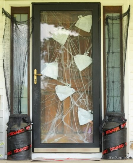 Outdoor Halloween Decor -- get ideas for decorating your porch for Halloween including a bloody doormat that you can make yourself!