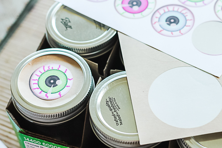 adding eyeball stickers to mason jars