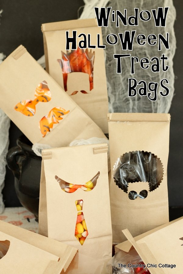 Window Halloween Treat Bags -- cut a few window in pre-made bags for Halloween treats that look amazing!