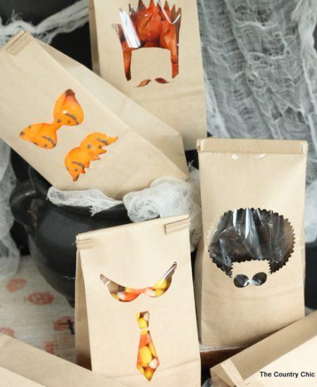 Window Halloween Treat Bags -- cut a few window in pre-made bags for Halloween treats that look amazing!