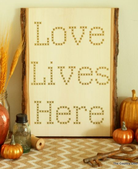 Make your own cross stitch sign on wood using vinyl and your Cricut Explore.
