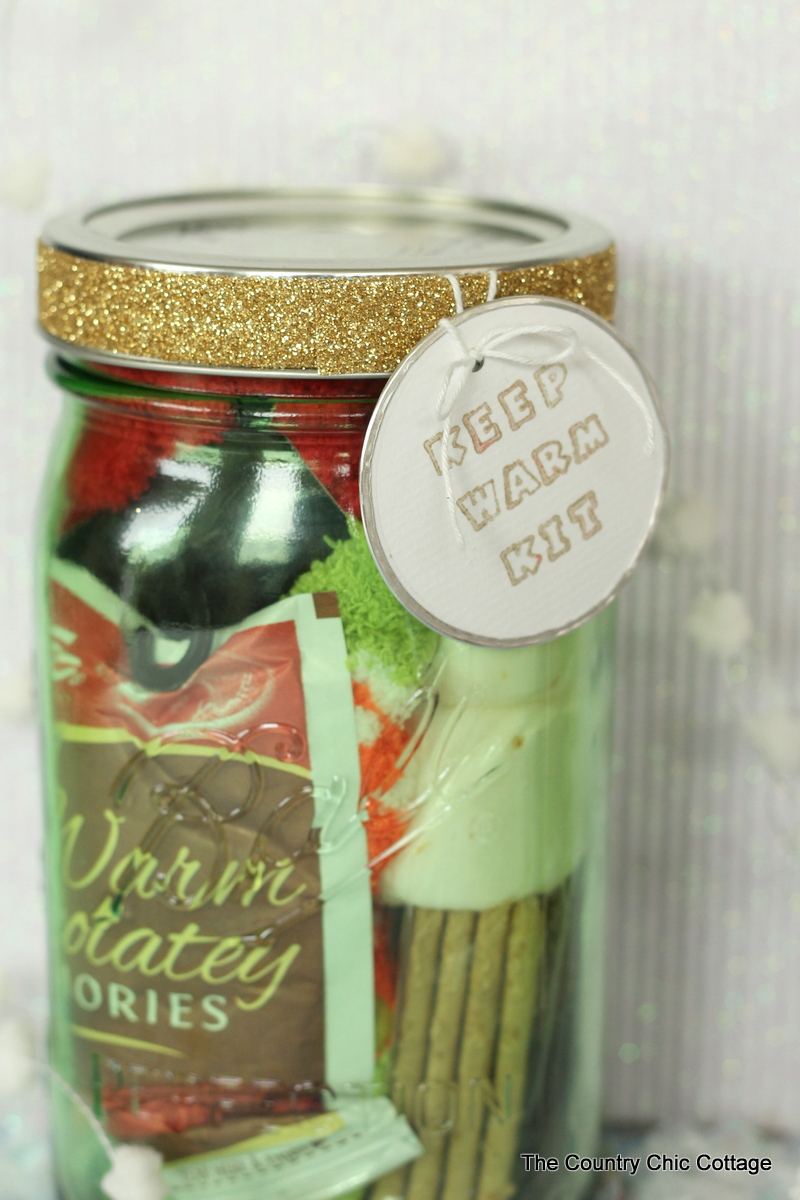 Keep warm kit gift in a jar -- perfect for cold winter holidays!  See the list of things to add to this fun mason jar gift idea!