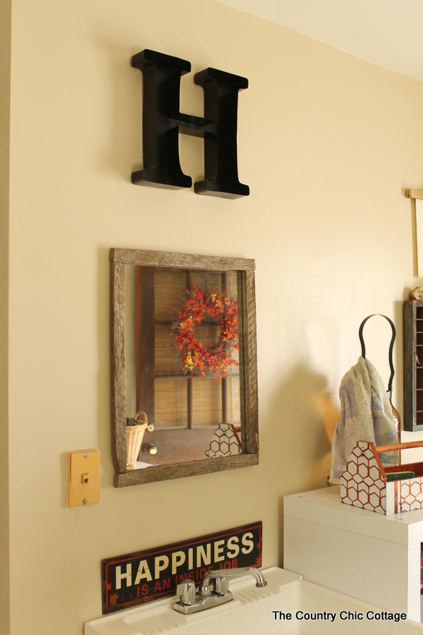 Making a barn wood frame for a mirror -- turn a plain builder grade mirror into something with farmhouse style!