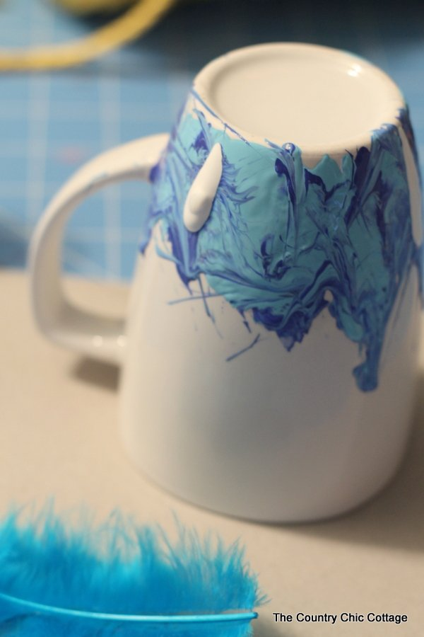 Adding white paint to the coffee mug