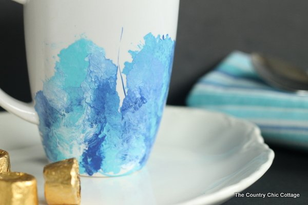 A white mug with blue marble design on the bottom of it