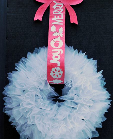Glittered Christmas Wreath -- learn how to add glitter to paper ribbon and hang up a gorgeous organza wreath!