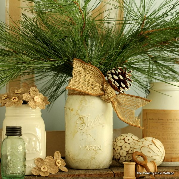 gold marbled mason jar displayed with other white mason jars