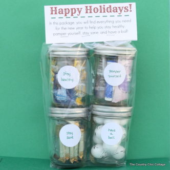 A fun stacked gift in a jar with a free printable topper. Give them everything they need to start the new year off right!
