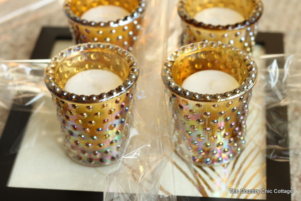 Put the votives in the candle holders and arrange them on the tray for an easy, affordable gift