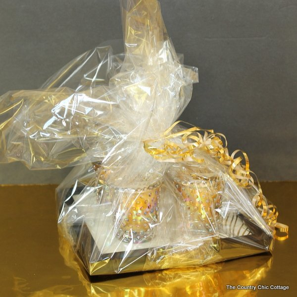 Wrap the candle tray with clear gift wrap and tie with a ribbon! This affordable gift idea cost less than $20