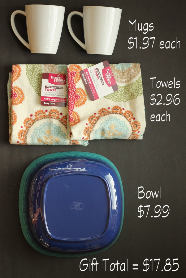 This gift idea only cost $18 and includes two coffee mugs, two tea towels, and a lovely blue serving bowl