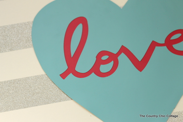 Love Canvas Art -- make this art for your home with duck tape and some vinyl cutouts -- super easy and gorgeous!