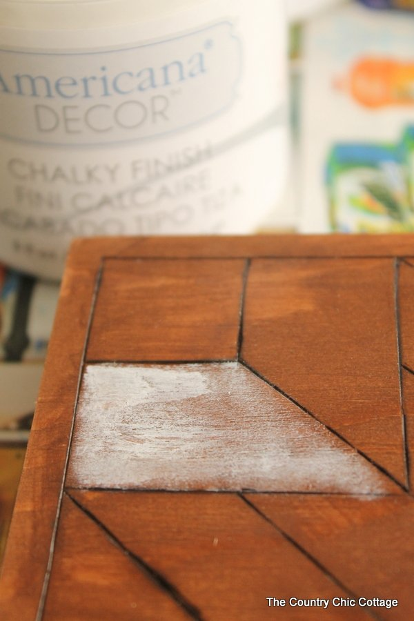 Start painting any section of your wood quilt square