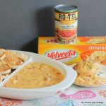 Artichoke Queso Dip Recipe -- add artichoke hearts to your favorite cheese dip for an out of this world snack idea!