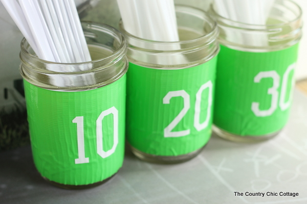 Mason jar utensil holder for any football party including the Super Bowl!
