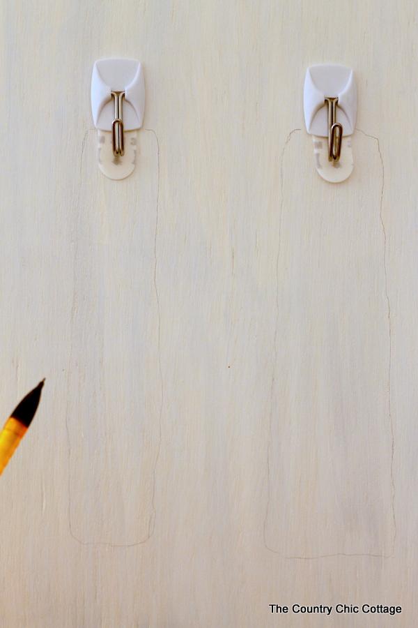Cabinet Door Organization -- use the pack of your door to hang necessities and get organized!