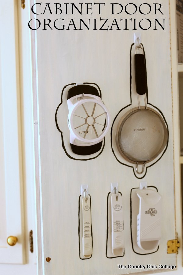 Cabinet Door Organization -- use the pack of your door to hang necessities and get organized!