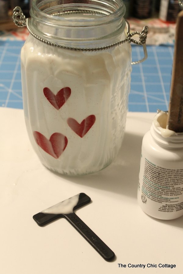 Glass etched mason jar lanterns -- perfect for weddings and so easy to make! I had no idea they made etching cream that you could re-use over and over!