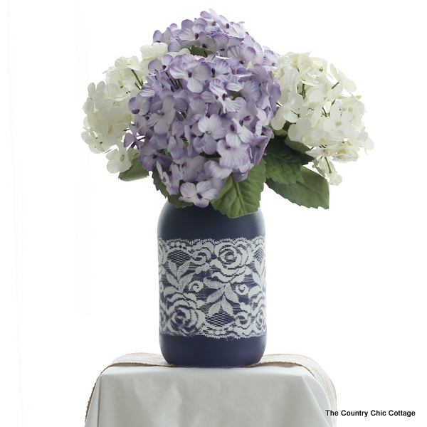 Lace Mason Jar Vase -- use two paint colors and lace as a mask to create this gorgeous painted vase for your wedding, home, or any party. Get the full step by step instructions here. Can you believe this is just paint? There is no actual lace on this jar!