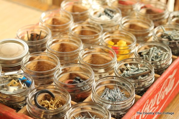 hardware organized into mason jars