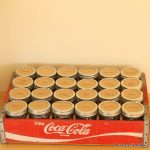Mason jar hardware organizer -- an old coke crate and mason jars can organize your screws, nails, bolts, and more!