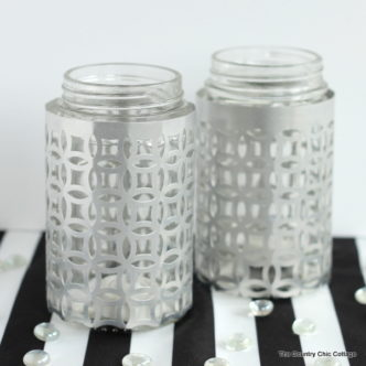 Wrap jars in metal for a gorgeous candle holder perfect for weddings or everyday use! These metal wrapped jar candle holders are so easy to make. Adding this to my must make list!