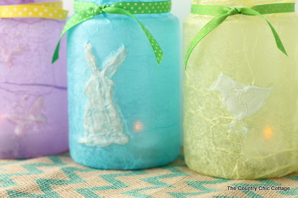 Adorn your Easter table with these jar crafts -- make from recycled pickle jars, hot glue, and tissue paper! An amazing budget friendly craft!