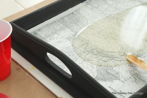 Make this vintage map tray including pouring epoxy to make a glass like surface.