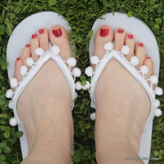 Pom Pom Fringe Flip Flops -- add fringe to a cheap pair of flip flops for an awesome summer fashion accessory!