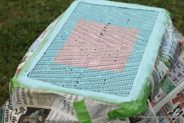Painted Wicker Table -- add a design to wicker with spray paint with just a few supplies.  Come see the step by step instructions!