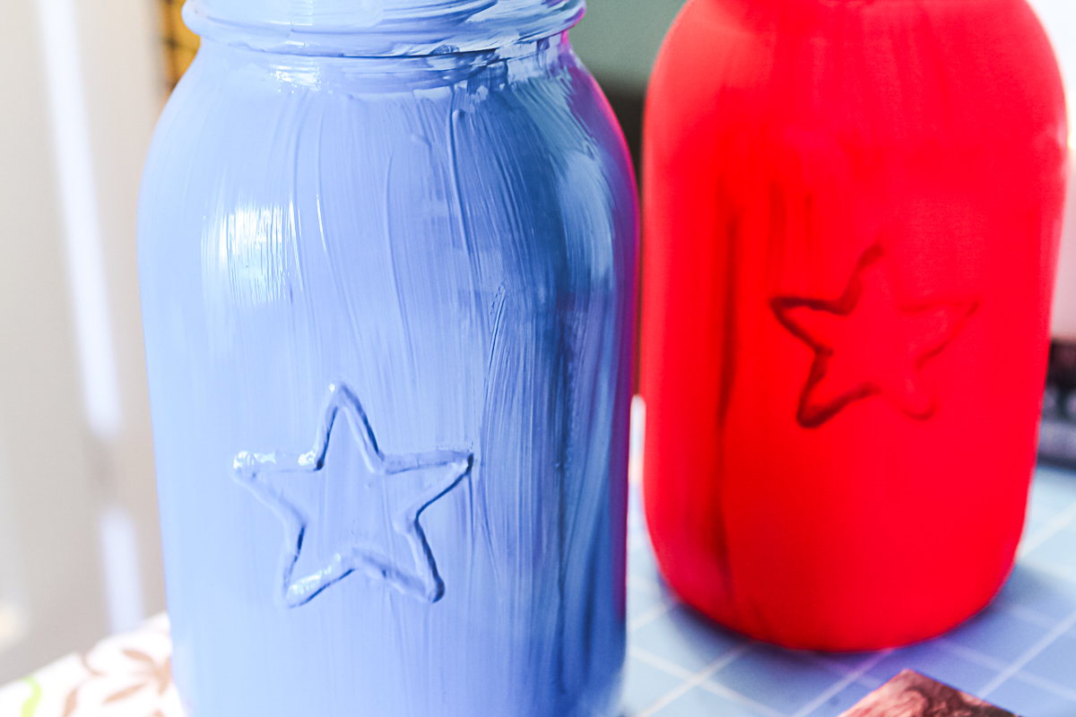 painting a mason jar red and blue