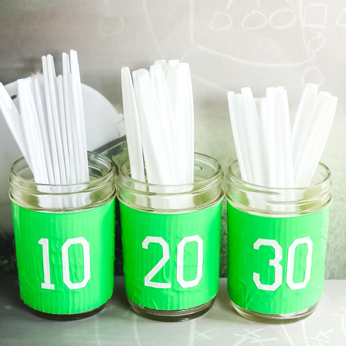 green mason jars with football numbers