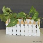 Make this picket fence planter box with a touch of gold leaf for your plants.