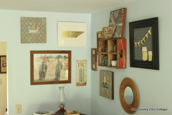 A rustic farmhouse gallery wall like this one will add character to your farmhouse style home.