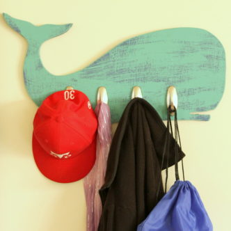 Baby shower guest book idea with free printable whale art! Turn this fun guest book into art for baby's nursery after the shower!