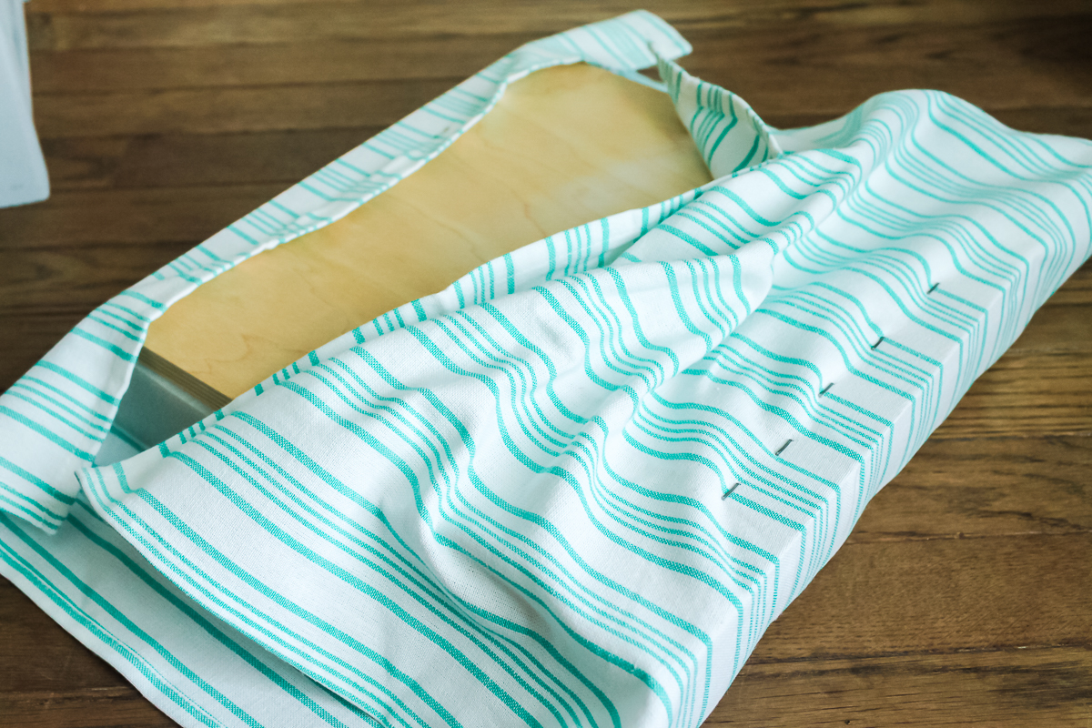 wrapping top of footstool in fabric