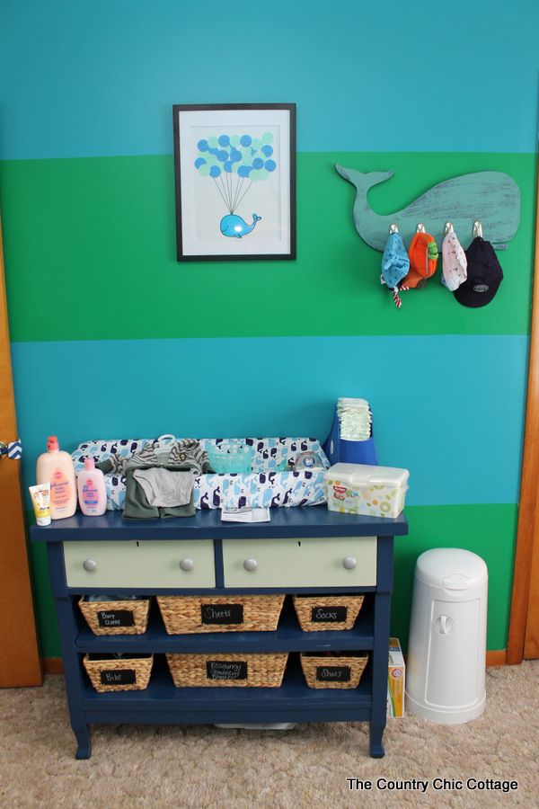 Turn a dresser into a changing table and more ideas in this nautical themed nursery!
