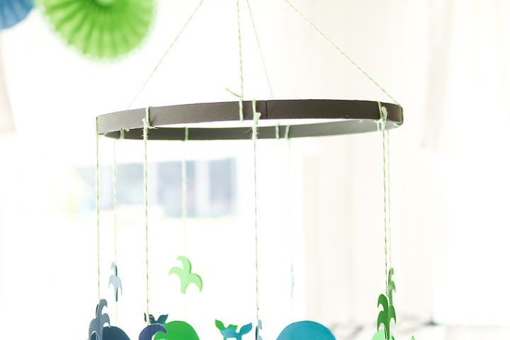 tie on strings of whales for a baby mobile