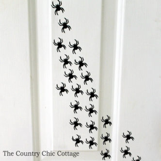 Add spiders to your door for a fun Halloween decoration!
