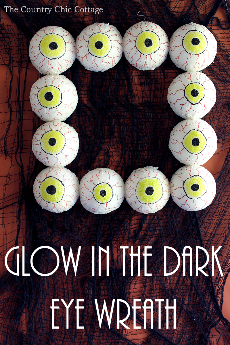 Make this glow in the dark eye wreath for your Halloween decorations this fall!