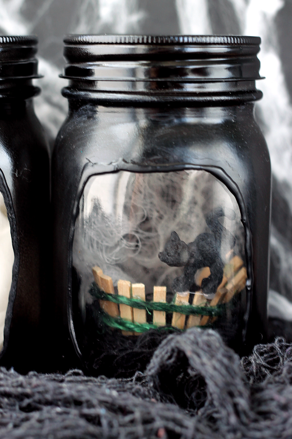 black cat inside of a mason jar