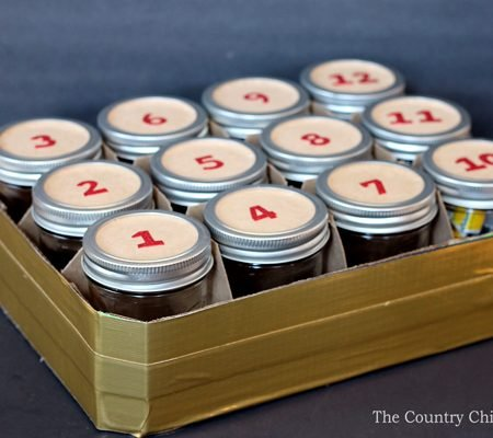 Turn a case of mason jars into an advent calendar for Christmas with this simple idea!