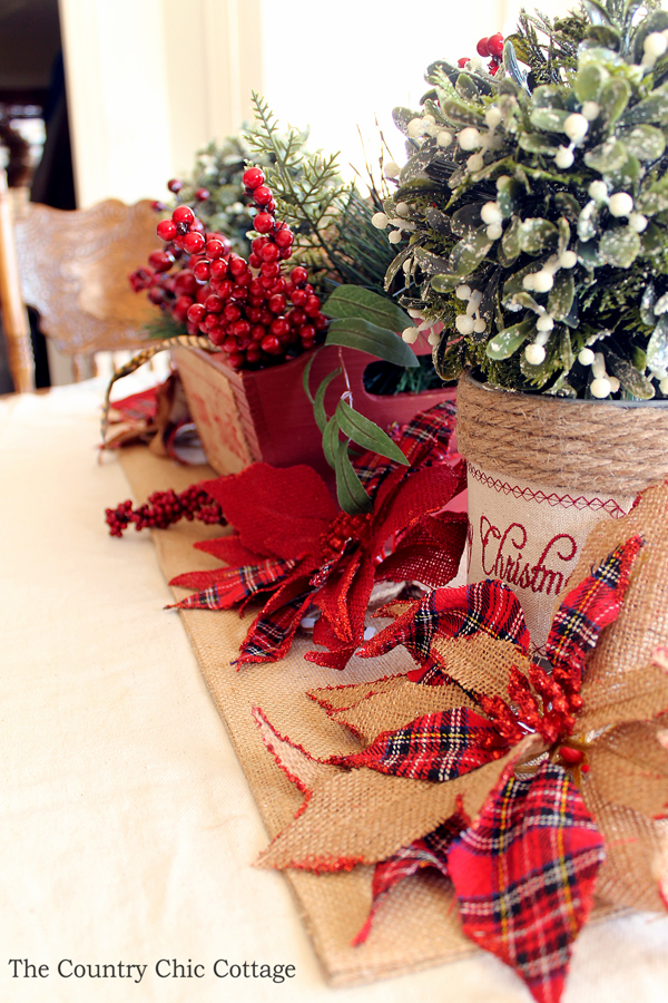 This is a great table centerpiece for Christmas! So easy to put together! I love the burlap poinsettias!