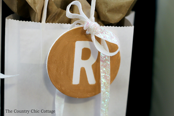 Make your own metallic gift tags with a monogram in just minutes! A fun craft idea that can add some sparkle to all of your Christmas gifts! Be sure to look here when you are wrapping your holiday presents!