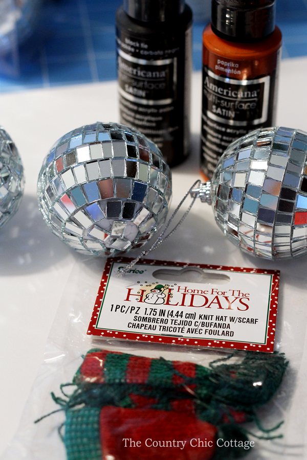Make this mirror ball snowman ornament in just minutes! A fun craft idea for your Christmas tree!