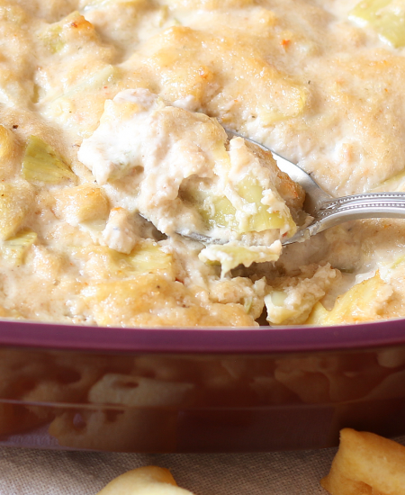 This hot artichoke dip with crab is perfect for any party! Be sure to make some for your next get together!