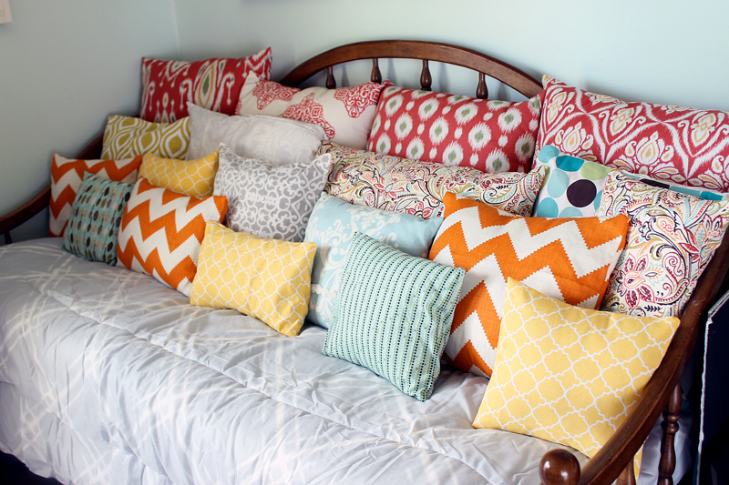 Using a day bed as a couch with this unique idea! Grab your pillows and get started!