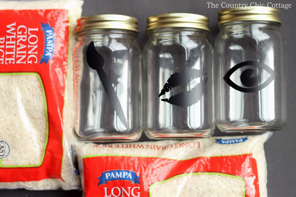 3 jars with labels next to two bags of white rice